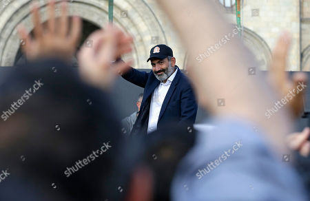Opposition lawmaker Nikol Pashinian waves to supporters during a rally in Yerevan on . Armenia's parliament plans to choose a replacement on Tuesday for Serzh Sargsyan, who resigned last week amid the street demonstrations over his selection as prime minister. Pashinian, who led the protests, hopes to be the next premier