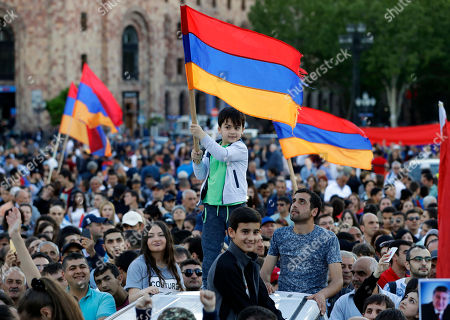 A young boy waves an Armenian flag during a rally in Yerevan on . Armenia's parliament plans to choose a replacement on Tuesday for Serzh Sargsyan, who resigned last week amid the street demonstrations over his selection as prime minister. Pashinian, who led the protests, hopes to be the next premier