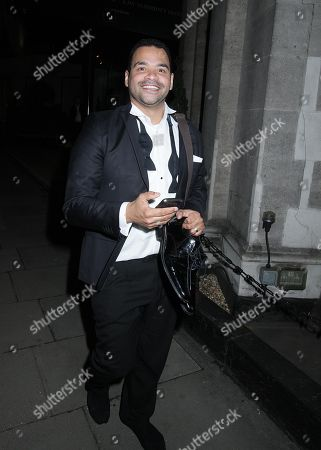 Stock Photo of Michael Underwood took off his shoes as he came out of the grosvenor house to go home so it is not only women that take of their shoes to wear nothing but men as well