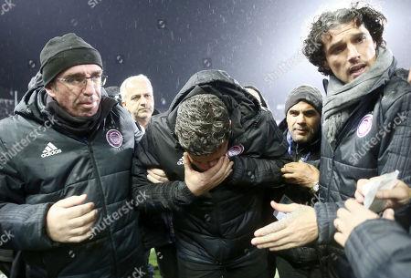 Olympiakos' manager Oscar Garcia after he got injured in the Toumba Stadium