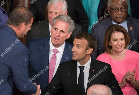 Emmanuel Macron, Kevin McCarthy, Nancy Pelosi. French President Emmanuel Macron is escorted by Majority Leader Kevin McCarthy, R-Calif., left, and House Minority Leader Nancy Pelosi, D-Calif., right, to address a joint meeting of Congress at the Capitol in Washington, . With House Speaker Paul Ryan planning to retire, McCarthy, the No. 2 House Republican, has the backing of President Donald Trump and Ryan to become speaker