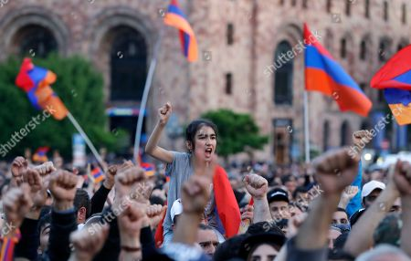 People wave Armenian flags during a rally in Yerevan on . Armenia's parliament plans to choose a replacement on Tuesday for Serzh Sargsyan, who resigned last week amid the street demonstrations over his selection as prime minister. Pashinian, who led the protests, hopes to be the next premier