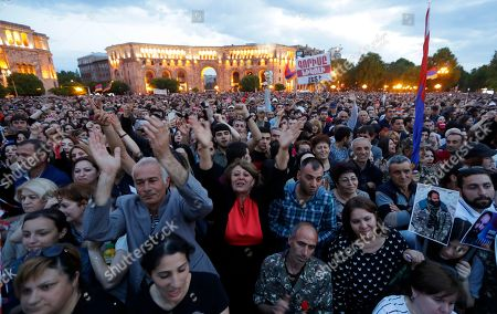Poeple gather during a rally in Yerevan on . Armenia's parliament plans to choose a replacement on Tuesday for Serzh Sargsyan, who resigned last week amid the street demonstrations over his selection as prime minister. Pashinian, who led the protests, hopes to be the next premier