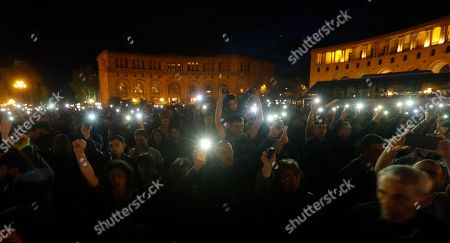 People hold up their mobile phone lights during a rally in Yerevan on . Armenia's parliament plans to choose a replacement on Tuesday for Serzh Sargsyan, who resigned last week amid the street demonstrations over his selection as prime minister. Pashinian, who led the protests, hopes to be the next premier