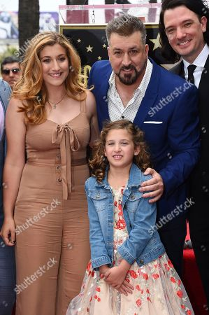 Kelly Baldwin, Joey Fatone, JC Chasez, Kloey Alexandria Fatone. Kelly Baldwin, from top left, Joey Fatone, JC Chasez and Kloey Alexandria Fatone, bottom center, attend a ceremony honoring NSYNC with a star on the Hollywood Walk of Fame, in Los Angeles