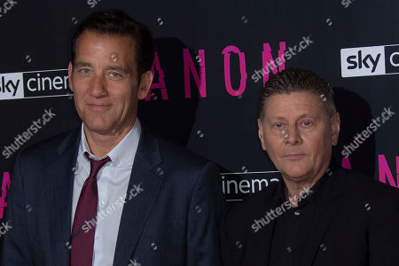 Clive Owen, Andrew Niccol. Actor Clive Owen poses for photographs with director/writer Andrew Niccol at the UK premiere screening of Anon in north London