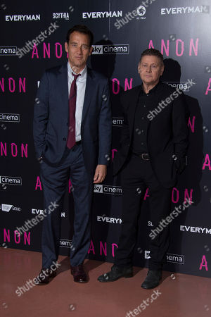 Stock Photo of Clive Owen, Andrew Niccol. Actor Clive Owen poses for photographs with director/writer Andrew Niccol at the UK premiere screening of Anon in north London