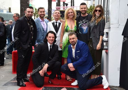 Stock Photo of Chris Kirkpatrick, Lance Bass, Paul Harless, Lynn Bomar Harless, Justin Timberlake, Jessica Biel, JC Chasez, Joey Fatone. Chris Kirkpatrick, standing from left, Lance Bass, Paul Harless, Lynn Bomar Harless, Justin Timberlake, Jessica Biel, and kneeling from left, JC Chasez and Joey Fatone attend a ceremony honoring NSYNC with a star on the Hollywood Walk of Fame, in Los Angeles