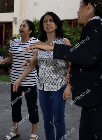 Peru's former First Lady Nadine Heredia, center, arrives home after she was released from prison in Lima, Peru, . A high court in Peru has ruled that former President Ollanta Humala and his wife must be freed from prison while prosecutors investigate their alleged involvement in multi-million dollar kickback schemes. They were jailed on July 14, 2017
