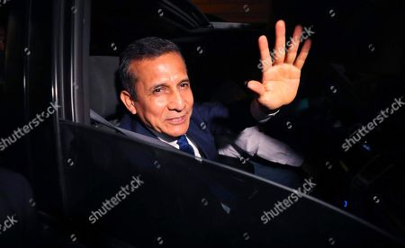 Peru's former President Ollanta Humala waves to the media from a car as he leaves prison after he was released in Lima, Peru, . A high court in Peru has ruled that Humala and his wife must be freed from prison while prosecutors investigate their alleged involvement in multi-million dollar kickback schemes. They were jailed on July 14, 2017