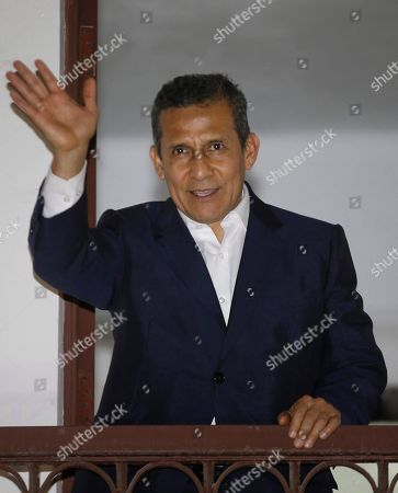 Peru's former President Ollanta Humala waves to the media from a balcony at his party's headquarters after he was released from prison in Lima, Peru, . A high court in Peru has ruled that Humala and his wife must be freed from prison while prosecutors investigate their alleged involvement in multi-million dollar kickback schemes. They were jailed on July 14, 2017