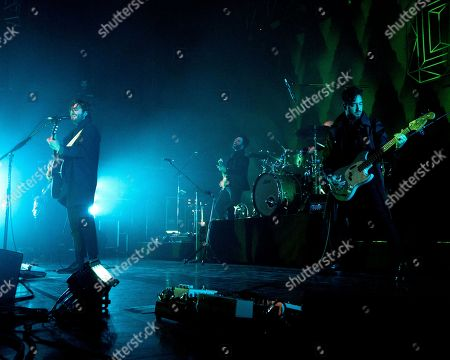 Ben Schneider, Brandon Walters, Miguel Briseño. The Los Angeles based alternative rock band Lord Huron with frontman Ben Schneider, left, touring guitarist Brandon Walters, and bass player Miguel Briseño, right. performs at the House of Blues, in Boston