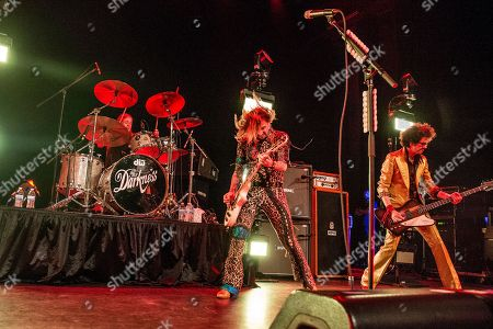 Justin Hawkins, Frankie Poullain. Justin Hawkins, left, and Frankie Poullain of The Darkness perform at the Civic Theatre, in New Orleans