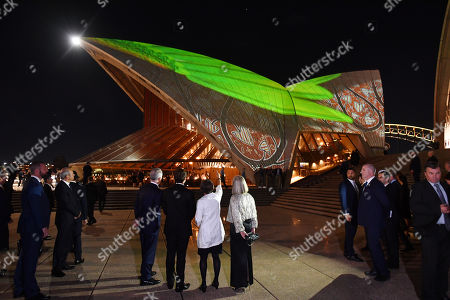 President of France Emmanuel Macron (C-L), Australia's Prime Minister Malcolm Turnbull (L) and his wife Lucy Turnbull (R) watch an indigenous themed light show Badu Gili at the Sydney Opera House in Sydney, Australia, 01 May 2018. President Macron is in Sydney for bilateral talks alongside Australian Prime Minister Malcolm Turnbull with trade and security expected to top the two day agenda setdown between 01 to 03 May.