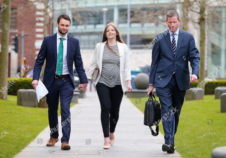 Daniel McArthur with wife Amy, who own the family run business, pictured with Sam Webster from the Christian Instute entering the Royal Courts of Justice in Belfast.