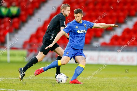 AFC Wimbledon defender Jonathan Meades (3) with a long ball  during the EFL Sky Bet League 1 match between Doncaster Rovers and AFC Wimbledon at the Keepmoat Stadium, Doncaster. Picture by Simon Davies