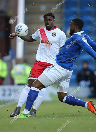 Tyler Reid of Newport County and Jerome Binnom Williams of Chesterfield compete for the ball