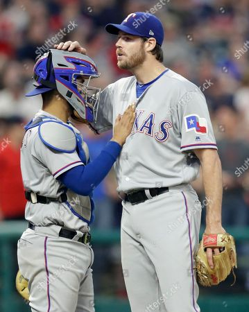 Doug Fister, Robinson Chirinos. Texas Rangers catcher Robinson Chirinos pats starting pitcher Doug Fister on the chest just before Fister is removed from the game in the seventh inning of a baseball game against the Cleveland Indians, in Cleveland