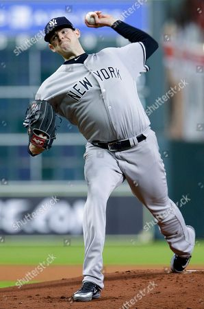 New York Yankees' starting pitcher Jordan Montgomery (47) throws against the Houston Astros during the first inning of a baseball game, in Houston