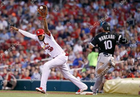 Chicago White Sox's Yoan Moncada (10) is out at first as St. Louis Cardinals first baseman Jose Martinez handles the throw during the third inning of a baseball game, in St. Louis