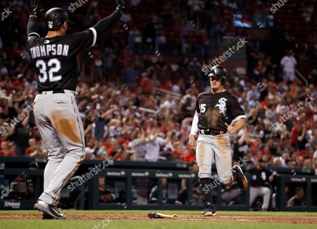 Chicago White Sox's Trayce Thompson (32) celebrates as teammate Adam Engel comes in to score on a two-run double by Yoan Moncada during the fourth inning of a baseball game against the St. Louis Cardinals, in St. Louis