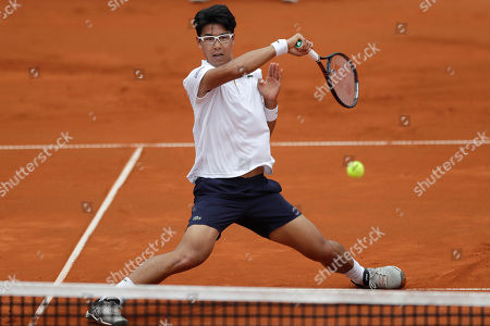 Hyeon Chung of South Korea returns the ball to Matthias Bachinger of Germany during the men's second round match at the ATP tennis tournament in Munich, Germany