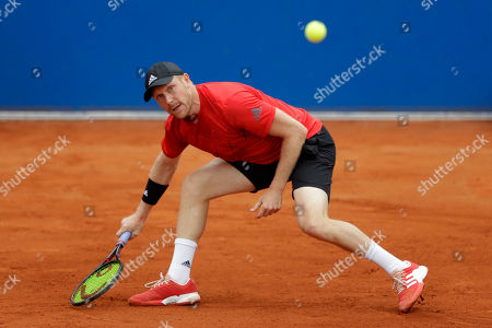 Matthias Bachinger of Germany returns the ball to Hyeon Chung of South Korea during the men's second round match at the ATP tennis tournament in Munich, Germany