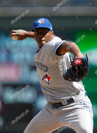 Toronto Blue Jays pitcher Carlos Ramirez throws against the Minnesota Twins in a baseball game, in Minneapolis
