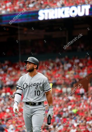 Chicago White Sox's Yoan Moncada walks back to the dugout after striking out during the sixth inning of a baseball game against the St. Louis Cardinals, in St. Louis