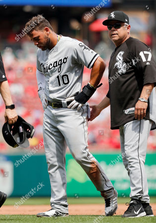 Chicago White Sox's Yoan Moncada (10) walks off the field after being injured sliding into third while manager Rick Renteria stands by during the eighth inning of a baseball game against the St. Louis Cardinals, in St. Louis