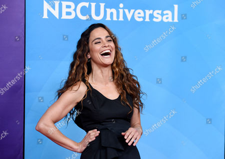 "Alice Braga, a cast member in the USA series ""Queen of the South,"" laughs with photographers during the 2018 NBCUniversal Summer Press Day, in Universal City, Calif"