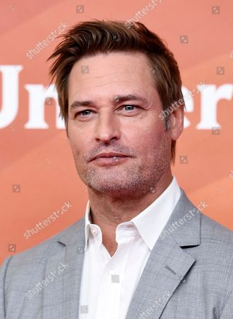 "Stock Picture of Josh Holloway, a cast member in the USA series ""Colony,"" poses during the 2018 NBCUniversal Summer Press Day, in Universal City, Calif"