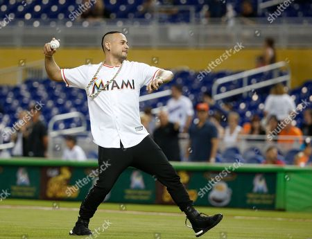 Latin recording artist Jacob Forever prepares to throw out a ceremonial first pitch before the start of a baseball game between the Miami Marlins and the Philadelphia Phillies, in Miami