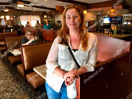 """Diane Neal poses at a diner, during an interview in Kingston, N.Y., discussing her campaign for the 19th congressional district. The former """"Law and Order"""" actress is seeking a new gig as representative of a sprawling congressional district in upstate New York"""