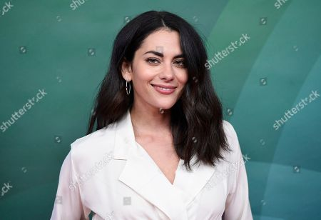 """Inbar Lavi, a cast member in the NBC television series """"Imposters,"""" poses during the 2018 NBCUniversal Summer Press Day, in Universal City, Calif"""