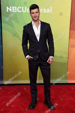 """Parker Young, a cast member in the NBC television series """"Imposters,"""" poses during the 2018 NBCUniversal Summer Press Day, in Universal City, Calif"""