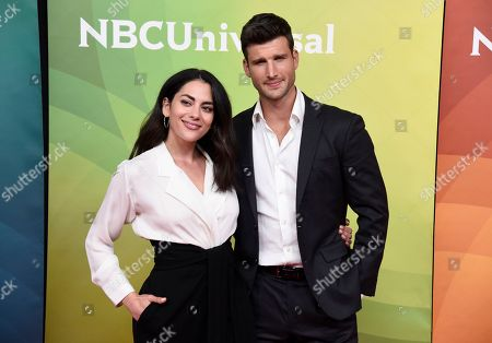"""Inbar Lavi, Parker Young. Inbar Lavi, left, and Parker Young, cast members in the NBC television series """"Imposters,"""" poses during the 2018 NBCUniversal Summer Press Day, in Universal City, Calif"""