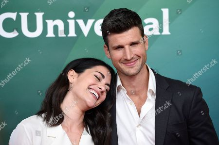 """Stock Image of Inbar Lavi, Parker Young. Inbar Lavi, left, and Parker Young, cast members in the NBC television series """"Imposters,"""" poses during the 2018 NBCUniversal Summer Press Day, in Universal City, Calif"""