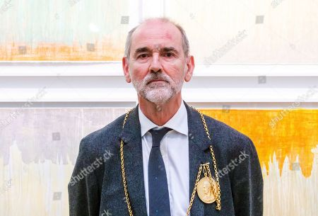 Christopher le Brun artist and President of the Royal Academy of Arts in front of his work