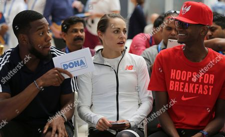 Mutaz Essa Barshim, Nathaneel Mitchell-Blake, Jenny Simpson. Great Britain's Nathaneel Mitchell-Blake, left, points to Qatar's high jump champion Mutaz Essa Barshim, as American runner Jenny Simpson, middle, looks on before the official press conference a day ahead of Diamond League in Doha, Qatar