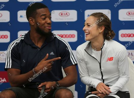 Nathaneel Mitchell-Blake, Jenny Simpson. Great Britain's Nathaneel Mitchell-Blake, left, points to American runner Jenny Simpson before the official press conference a day ahead of Diamond League in Doha, Qatar