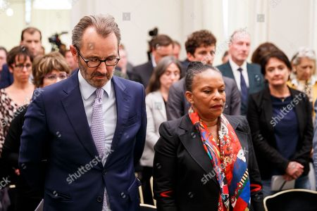Raymond Loretan (L), board member of the Centre for Humanitarian Dialogue (HD), Christiane Taubira (R), former Minister of Justice of France, along with other guests stands for a minute of silence after New Zealand's David Harland (unseen), Executive Director of the HD Centre, announced the full dissolution of the Basque separatist group ETA (Euskadi Ta Askatasuna), which they officially announced in a letter, during a media conference at the Centre for Humanitarian Dialogue, in Geneva, Switzerland, 03 May 2018. Others are not identified.