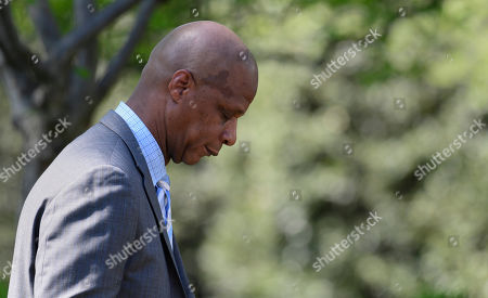 Retired Major League Baseball player Darryl Strawberry bows his head in prayer during a National Day of Prayer event with President Donald Trump in the Rose Garden of the White House in Washington