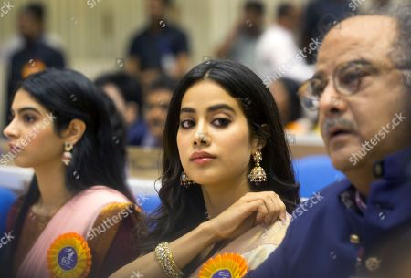 """Bollywood actress Sridevi's husband Boney Kapoor, right, and daughters Janhvi Kapoor, center, and Khushi Kapoor attend the 65th National Film Awards ceremony in New Delhi, India, . Sridevi received the Best Actress award posthumously for her film """"Mom"""