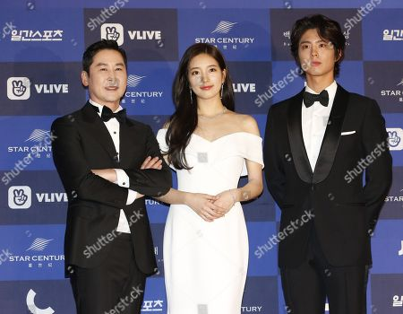 Stock Image of South Korean gagman Shin Dong-yeop (L), South Korean girl group 'miss A' member, singer and actress suzy of Bea Soo-ji (C) and South Korean actor Park Bo-gum (R) pose as they arrive for the 54rd annual Baeksang Art Awards at the Coex mall in Seoul, South Korea, 03 May 2018. The award ceremony for the BaekSang Arts Awards is a comprehensive art prize that focuses on screenings of movies, TV, and other works of popular culture among the public.