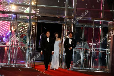 Stock Picture of South Korean gagman Shin Dong-yeop (L), South Korean girl group 'miss A' member, singer and actress suzy of Bea Soo-ji (C) and South Korean actor Park Bo-gum (R) pose as they arrive for the 54rd annual Baeksang Art Awards at the Coex mall in Seoul, South Korea, 03 May 2018.The award ceremony for the BaekSang Arts Awards is a comprehensive art prize that focuses on screenings of movies, TV, and other works of popular culture among the public.