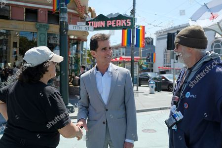 """Mayoral candidate Mark Leno talks with people in the Castro District of San Francisco. San Francisco could make history by electing for mayor the first African-American woman, Asian-American woman or openly gay man in a contest that is also the first truly competitive mayoral race the city has seen in 15 years. Former state Sen. Mark Leno, 66, who moved to San Francisco in the """"disco '70s"""" as part of an influx of gay newcomers, could be the city's first openly gay mayor four decades after Harvey Milk made LGBT history by winning a supervisor's seat. Milk and then-Mayor George Moscone were assassinated in 1978"""