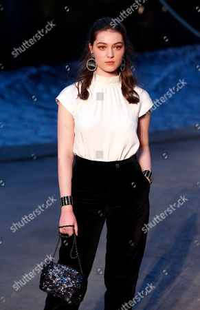 Actress Anamaria Vartolomei poses during a photocall before Chanel's Cruise 2018/2019 fashion collection presented in Paris