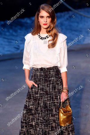 Model Dolores Doll poses during a photocall before Chanel's Cruise 2018/2019 fashion collection presented in Paris