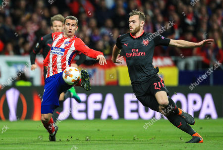 Antoine Griezmann of Atletico Madrid and Calum Chambers of Arsenal
